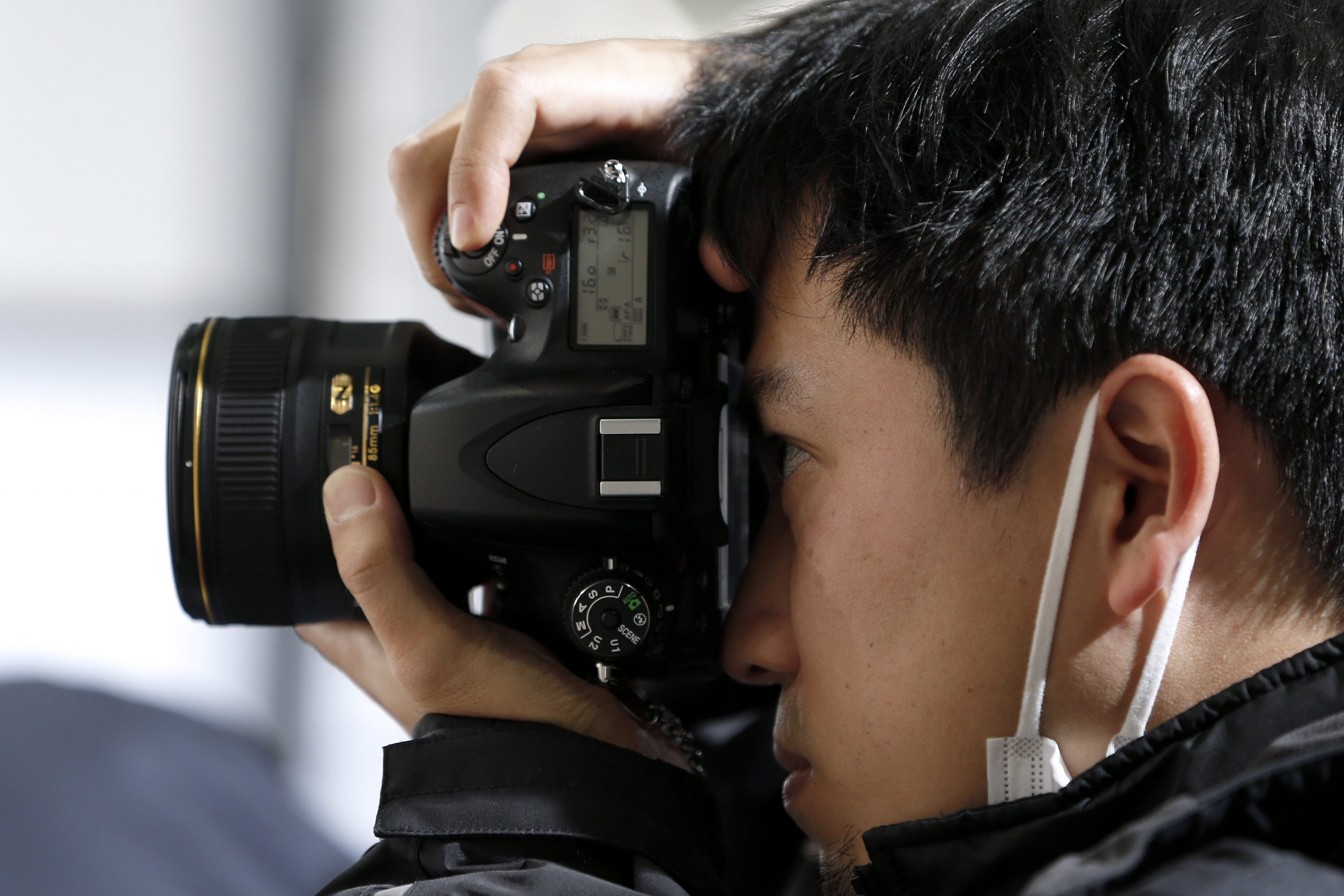 A close up of a person holding a camera