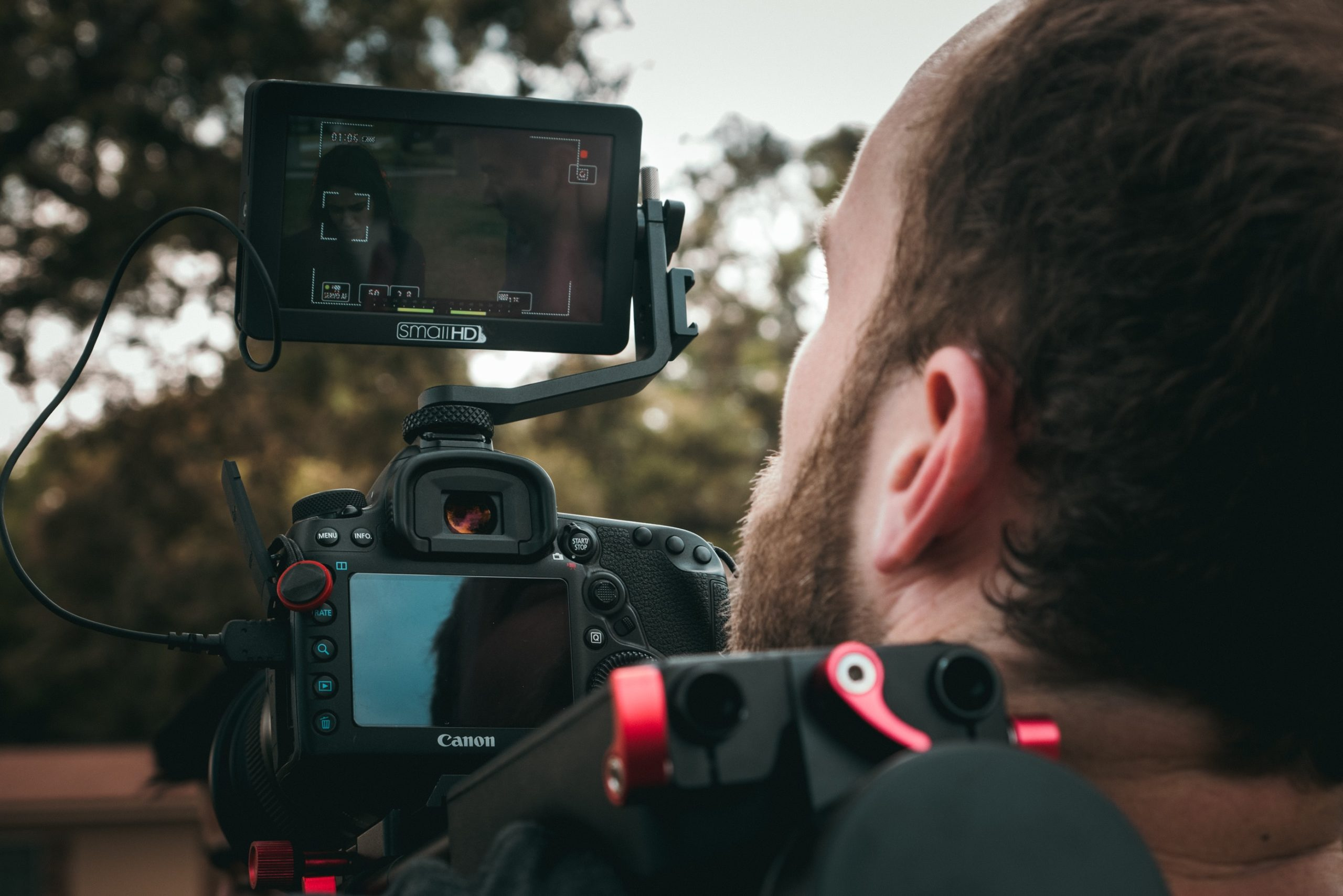 A close up of a man holding a camera
